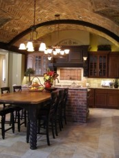 an arched brick ceiling and a matching kitchen island make the space catchier, bolder and bring texture inside
