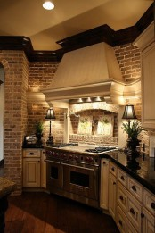 a brick statement wall adds interest to the traditional kitchen done in neutrals and brings texture