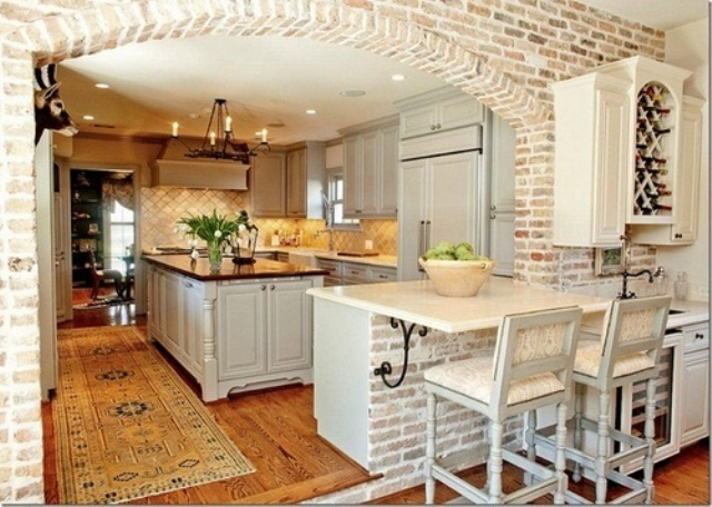 whitewashed bricks and neutral tiles make up a stylish kitchen with a rustic and vintage feel