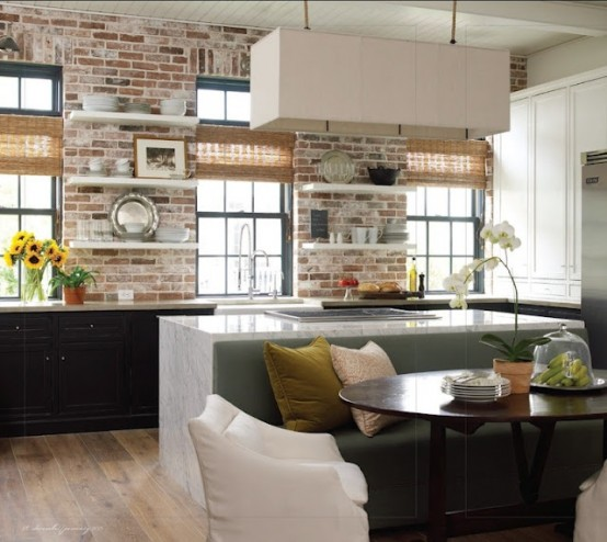 whitewashed bricks contrast the black cabinets and highlight them at the same time