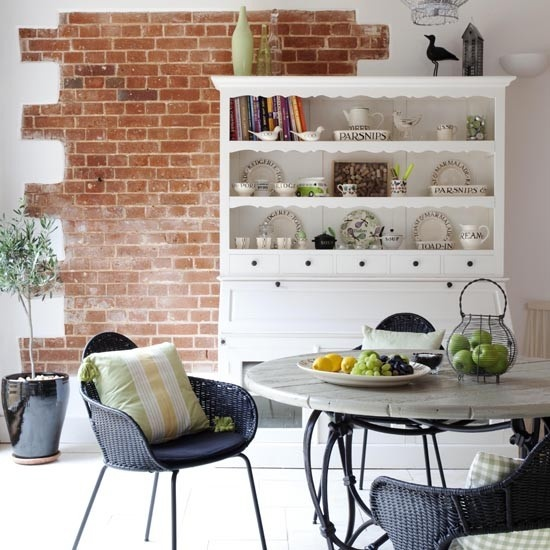 a piece of red brick in the dining zone for more eye catchiness and a bolder look of the space