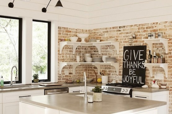 distressed and whitewashed brick walls and white kitchen furniture create a relaxed and distressed rustic feel