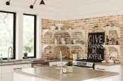 a neutral rustic kitchen with whitewashed bricks, white shelves and cabinets plus much natural light