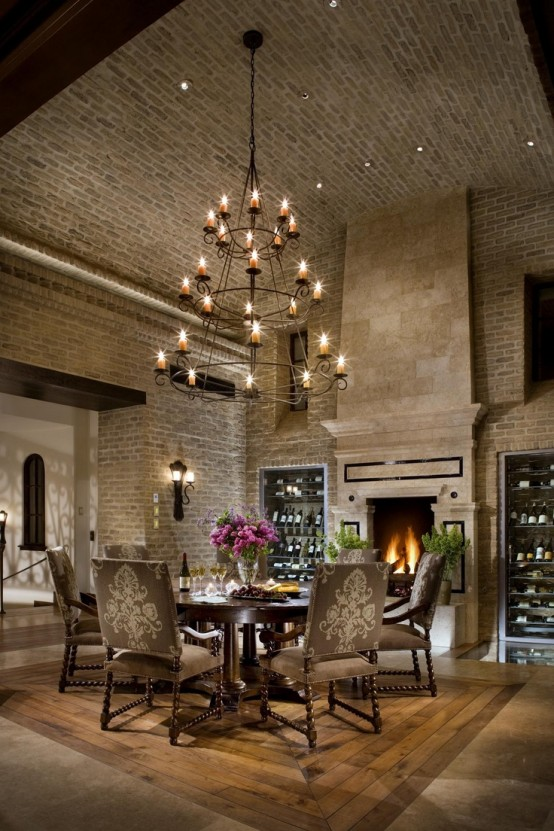 a formal vintage dining room with original brick walls and an arched ceiling looks very elegant and refined