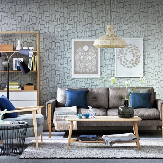 an eclectic living room with mid-century modern furniture, wicker lampshades and neutral artworks