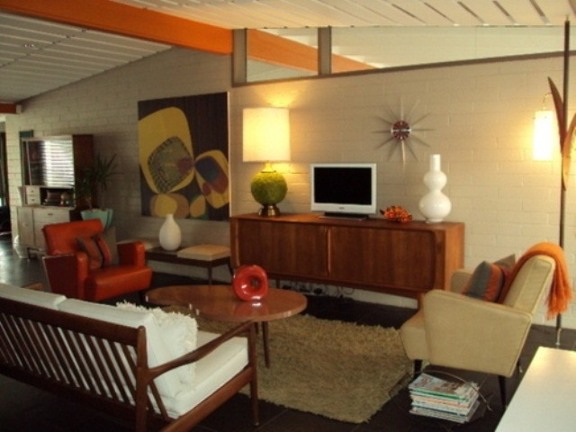 a neutral living room with touches of orange and amber plus elegant warm colored stain on the furniture