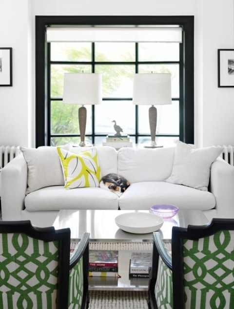 a mid-century modern meets art deco living room with touches of black for drama and some bright prints