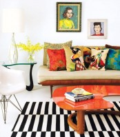 a bright mid-century modern living room with elegant furniture, bright artworks, colorful and printed pillows