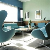 a blue and green living room with plywood panels, blue furniture and curtains and green walls