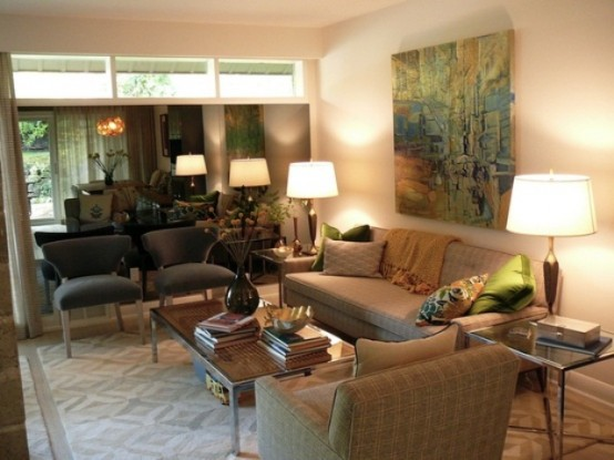 a neutral living room with an artwork, plaid furniture, prints and lamps for a welcoming and cozy look