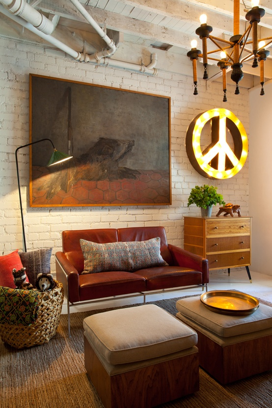 an eclectic living room with industrial touches, mid-century modern furniture and creative artworks