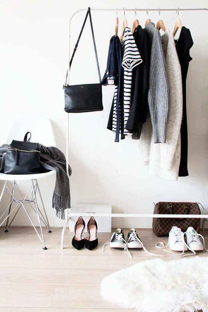 a white makeshift closet and a stool are all you need for a small wardrobe, the space feels Scandinavian