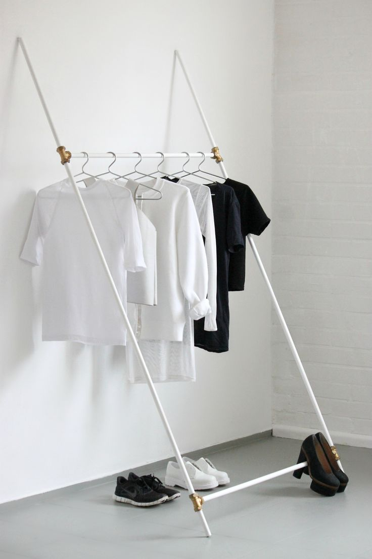 a chic white minimal makeshift closet is an airy and easy thing, even a tiny space can accommodate it