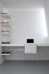 a minimalist white home office with a skylight, a built-in desk and matching shelves plus a white chair is a cool space to work