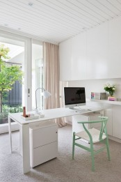 a minimalist home office with a view, a sleek white desk and storage cabinets, sleek storage units, a pastel green chair with a woven seat