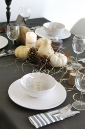 gourds and pumpkins, hay and pinecones, tree stumps and simple white porcelain for a modern tablescape