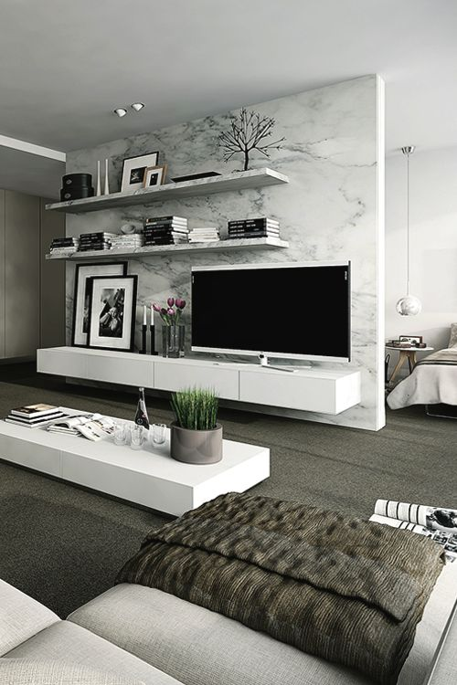 a modern floating TV unit in white, some shelves and a white coffee table with a storage space for effective storing