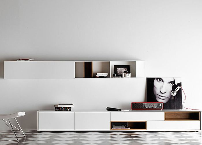 a modern and laconic white wall mounted storage unit and a matching TV unit under it will give you enough storage space