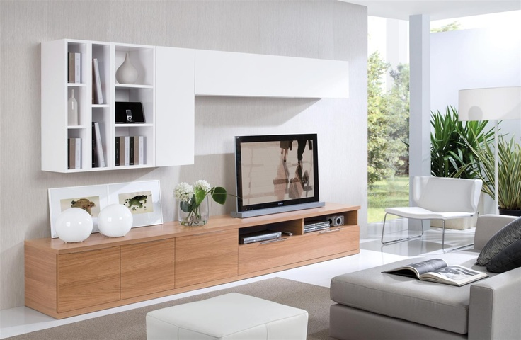 a white wall mounted storage unit with opened and closed compartments and a light stained wooden floating addition make up a stylish combo