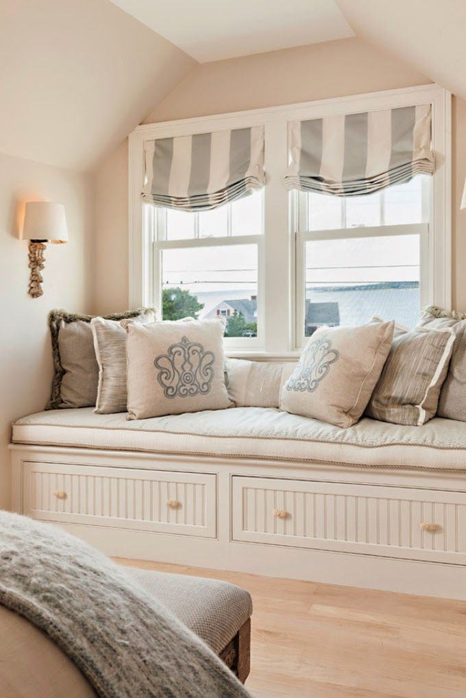 grey and white striped Roman shades accent the room and block out the sun very well if needed, they match the style of the room