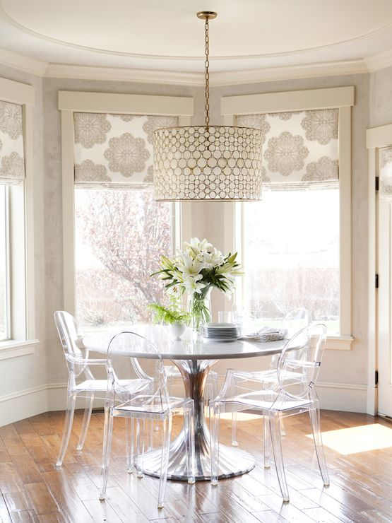 beautiful neutral and floral print Roman shades accent the space and make the nook cozy, cool and more refined