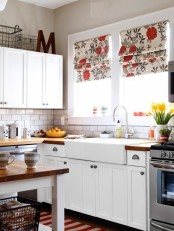 bright floral print Roman shades add color and print to the kitchen and match the decor very chic and very cool