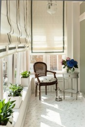 white and grey Roman shades make this balcony extremely elegant and chic and add a sophisticated touch blocking out the sun