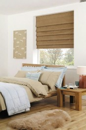 a burlap Roman shade is a cool and cozy idea to add a warm rustic feel to the space