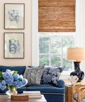 a woven Roman shade for adding a rustic and cozy feel to the space, and it blocks out the sun in a great way