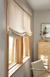 a neutral Roman shade will add a cozy feel to the room and will block out the sun being private at the same time