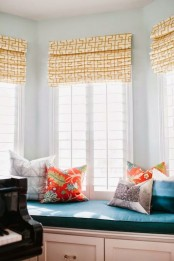 a yellow printed Roman shade is a bright and cool touch to the room, and it may add an elegant feel to any room