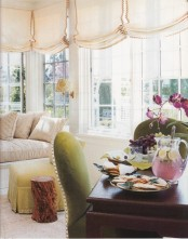 neutral Roman shades with edges add a chic and refined touch to the space and make it more private when needed