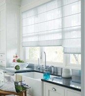 neutral striped Roman shade adds coziness to the kitchen and perfectly matches the farmhouse spaces at the same time