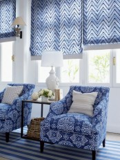 blue chevron print Roman shades add color and print to the living room and make the space very welcoming