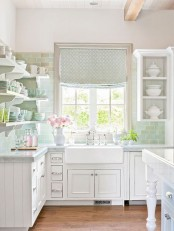 a silver printed Roman shade is a perfect addition to the farmhouse kitchen, and it adds color and print to the space