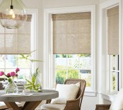 burlap Roman shades on a bay window will stick to your rustic or farmhouse style and will make the space look cozier and cooler