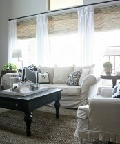 woven Roman shades paired with white curtains – only curtains feature not so much light blocking, and shades help with that
