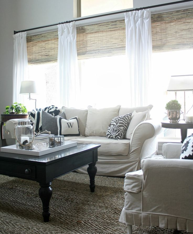 woven Roman shades paired with white curtains   only curtains feature not so much light blocking, and shades help with that