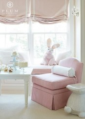 lovely pink and white Roman shades are a beautiful and delicate window treatment for a little girl's room and they add elegance