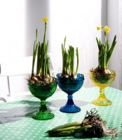 colorful glasses with spring bulbs are a cool modern centerpiece idea