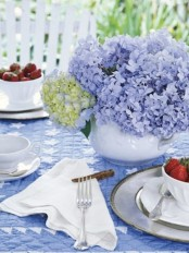 a bright hydrangea spring centerpiece in blue and green for your tablescape