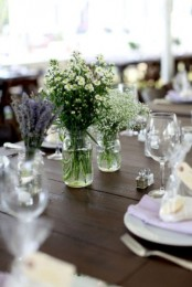simple neutral wildflower centerpieces are always good for a spring table