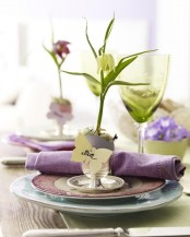 a cute spring place setting done in green and purple and an egg card holder