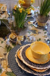 a bright navy and yellow place setting with various patterns