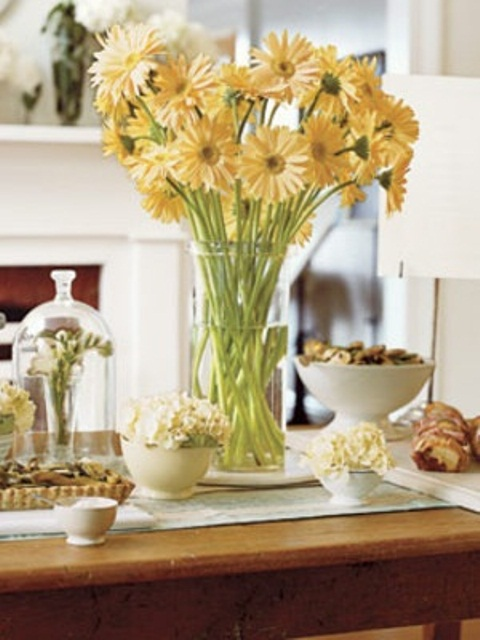 a bright yellow floral centerpiece is a great idea for a spring table setting