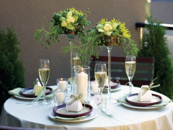 a chic spring tablescape with green and yellow centerpieces, green napkins and candles