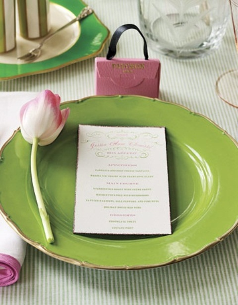 a green and pink spring place setting with a tulip