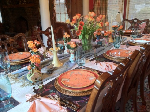 a colorful spring tablescape done in orange and blues with a vintage feel