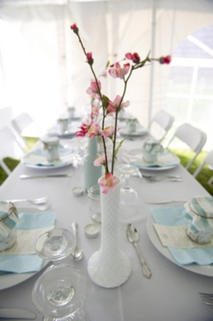 white vases with cherry blossom are perfect as spring centerpieces