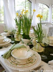 daffodils in vases and pots and some funny bunnies for a centerpiece